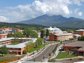 Northern Arizona University campus in the summer showing buildings in the foreground and the Peaks in the background
