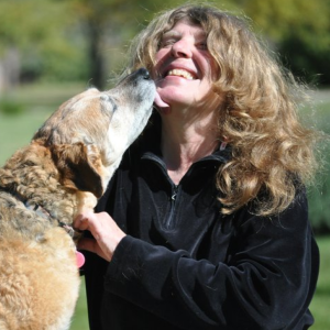 Portrait of Sally Evans with her dog