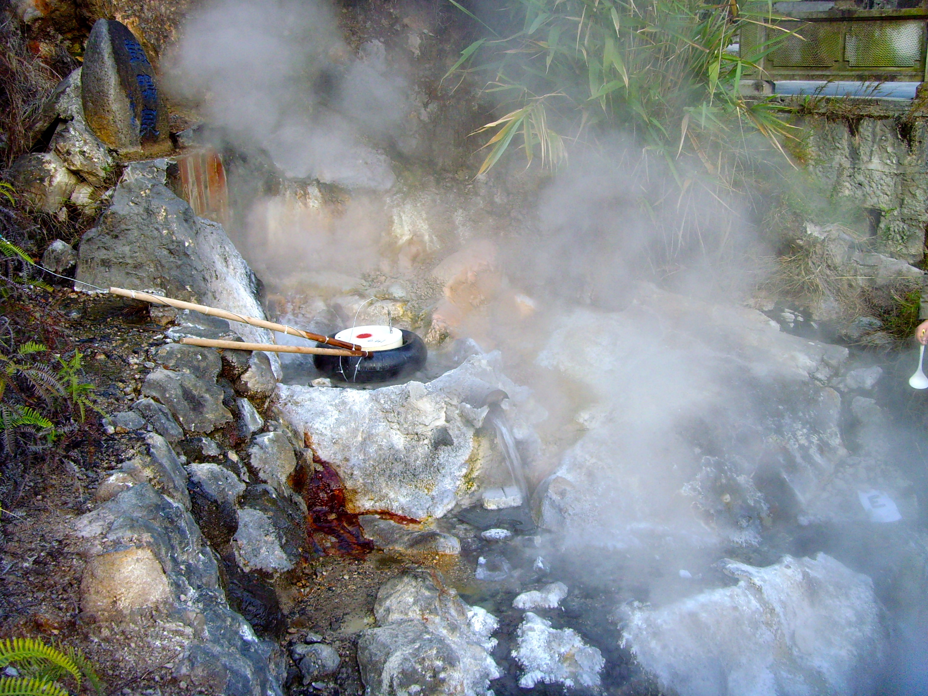 Steam rolling out of a hot spring.