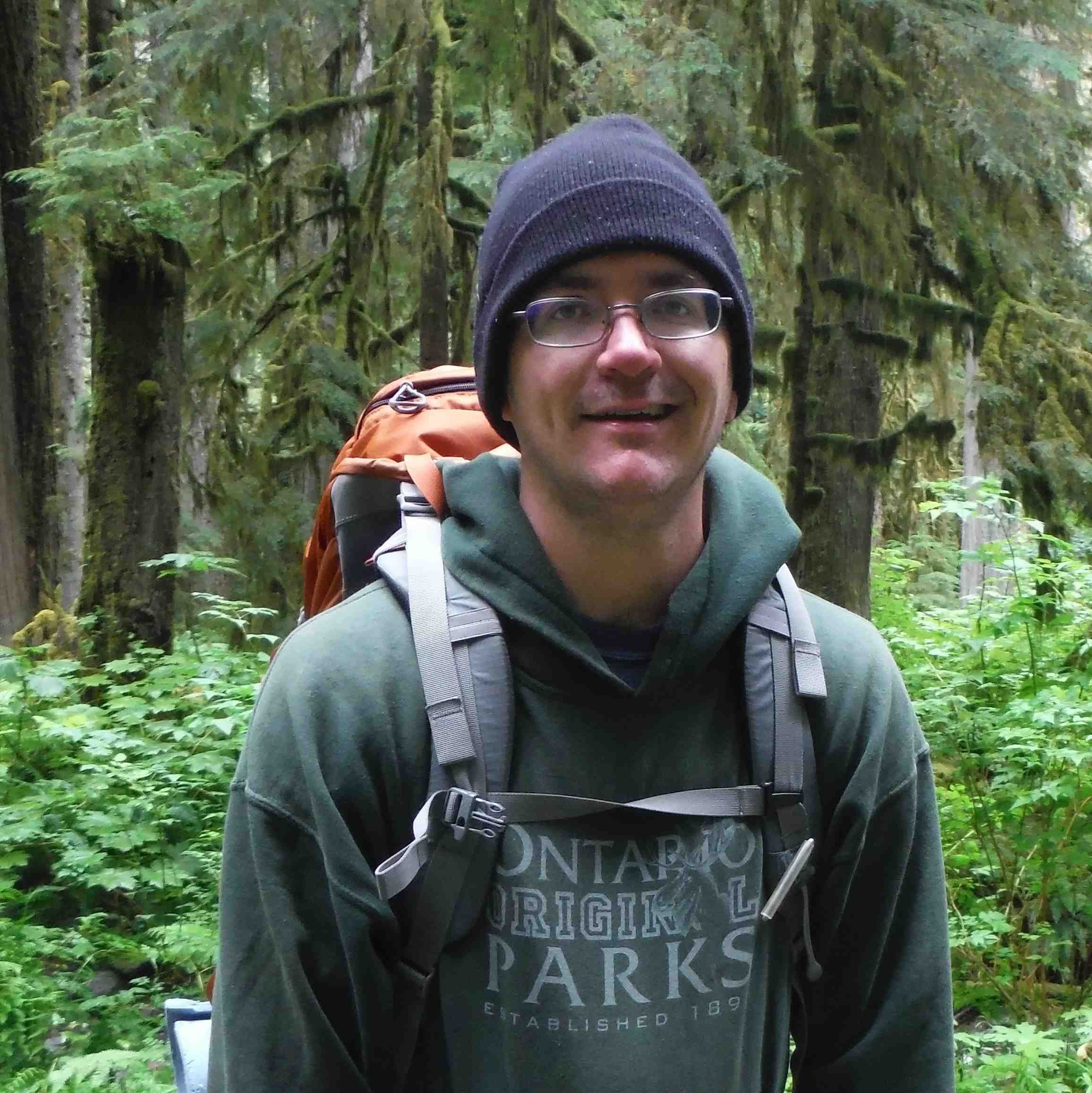 Portrait of Chris Ebert, visiting researcher in a forest
