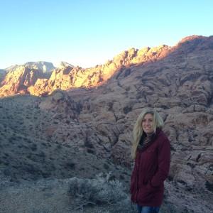 Portrait of Xanthe Walker, post-doctoral scientist, in rocky landscape.